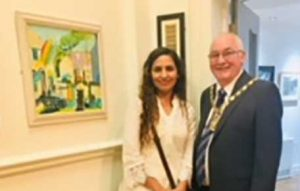 Varsha Rai, with her painting at Chapel gallery, Ormskirk, Lancashire, member of the sefton art group, art class for beginners and those more advanced